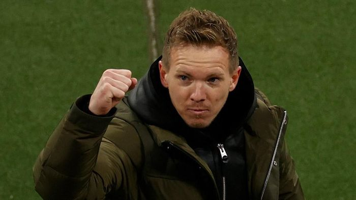 Leipzigs German headcoach Julian Nagelsmann celebrates after the UEFA Champions League Group H football match RB Leipzig v Manchester United in Leipzig, eastern Germany, on December 8, 2020. (Photo by Odd ANDERSEN / various sources / AFP)