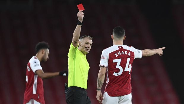 Arsenal's Granit Xhaka is shown a red card by the referee and sent off during an English Premier League soccer match between Arsenal and Burnley at the Emirates stadium in London, England, Sunday Dec. 13, 2020. (Laurence Griffiths/Pool via AP)