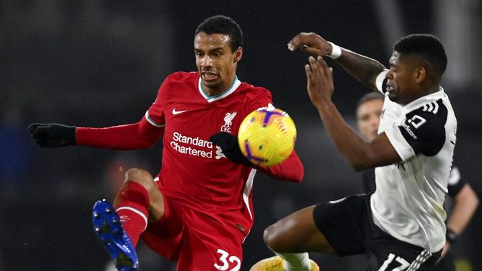 Fulhams Ivan Cavaleiro vies for the ball with Liverpools Joel Matip, left, during the English Premier League soccer match between Fulham and Liverpool, at Craven Cottage stadium, London, Sunday, Dec. 13, 2020. (Mike Hewitt/Pool via AP)