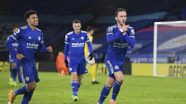 Leicester's James Maddison, right, celebrates his goal against Brighton during the English Premier League soccer match between Leicester city and Brighton, at the King Power Stadium in Leicester, England, Sunday, Dec. 13, 2020. (Michael Regan/Pool via AP)