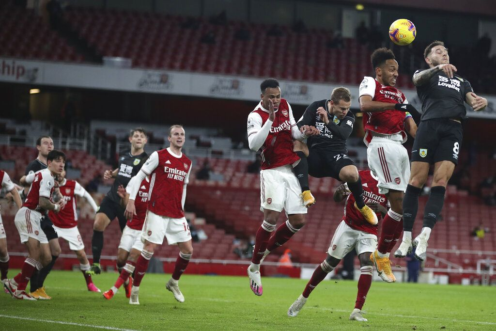 The ball skims off the head of Arsenal's Pierre-Emerick Aubameyang, 2nd right for an own-goal during an English Premier League soccer match between Arsenal and Burnley at the Emirates stadium in London, England, Sunday Dec. 13, 2020. (Nick Potts/Pool via AP)