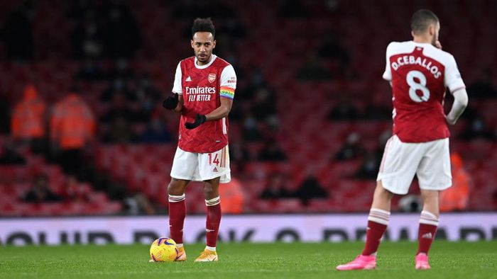 LONDON, ENGLAND - DECEMBER 13: Pierre-Emerick Aubameyang of Arsenal reacts after scoring an own goal during the Premier League match between Arsenal and Burnley at Emirates Stadium on December 13, 2020 in London, England. A limited number of spectators (2000) are welcomed back to stadiums to watch elite football across England. This was following easing of restrictions on spectators in tiers one and two areas only. (Photo by Laurence Griffiths/Getty Images)