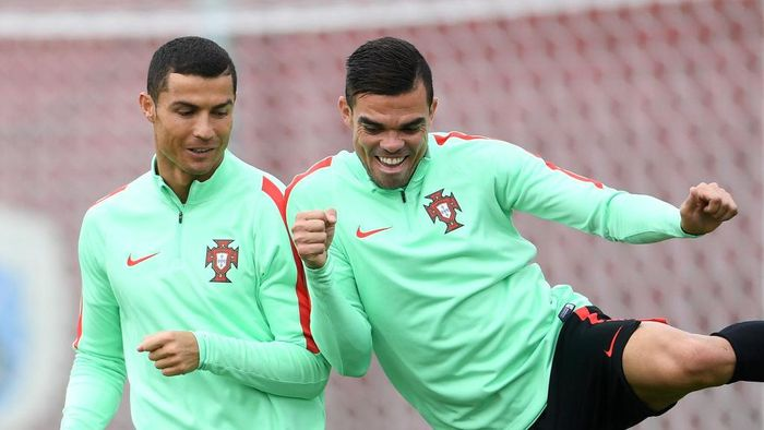 KAZAN, RUSSIA - JUNE 27: Cristiano Ronaldo of Portugal shares a joke with Pepe during a training session at Stadium Rubin on June 27, 2017 in Kazan, Russia.  (Photo by Laurence Griffiths/Getty Images)