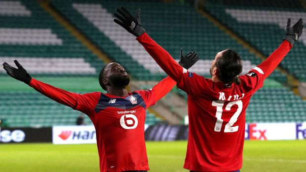 GLASGOW, SCOTLAND - DECEMBER 10: Jonathan Ikone of Lille  celebrates after scoring their team's first goal Yusuf Yazici of Lille during the UEFA Europa League Group H stage match between Celtic and LOSC Lille at Celtic Park on December 10, 2020 in Glasgow, Scotland. The match will be played without fans, behind closed doors as a Covid-19 precaution. (Photo by Ian MacNicol/Getty Images)