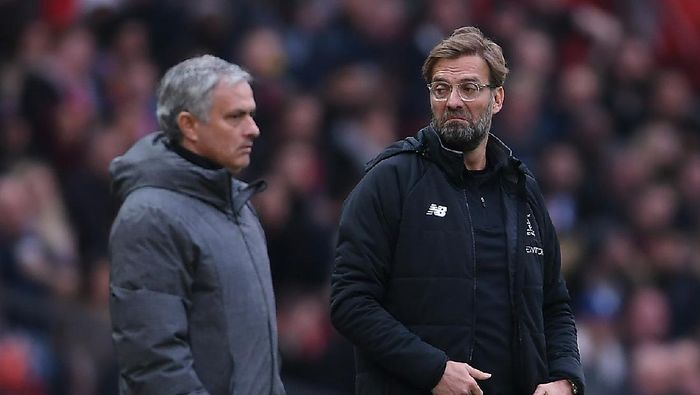 MANCHESTER, ENGLAND - MARCH 10:  Jose Mourinho of Manchester United and Jurgen Klopp of Liverpool look on during the Premier League match between Manchester United and Liverpool at Old Trafford on March 10, 2018 in Manchester, England.  (Photo by Laurence Griffiths/Getty Images)