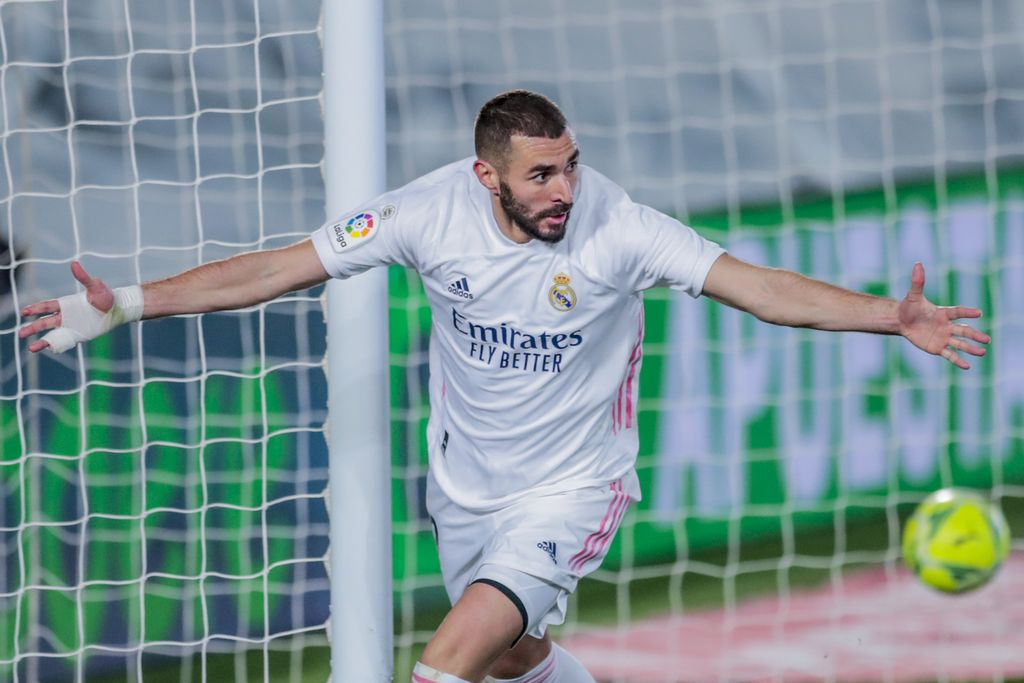 Real Madrid's Karim Benzema celebrates after scoring his side's second goal during the Spanish La Liga soccer match between Real Madrid and Athletic Club Bilbao at the Alfredo Di Stefano stadium in Madrid, Spain, Tuesday, Dec. 15, 2020. (AP Photo/Bernat Armangue)