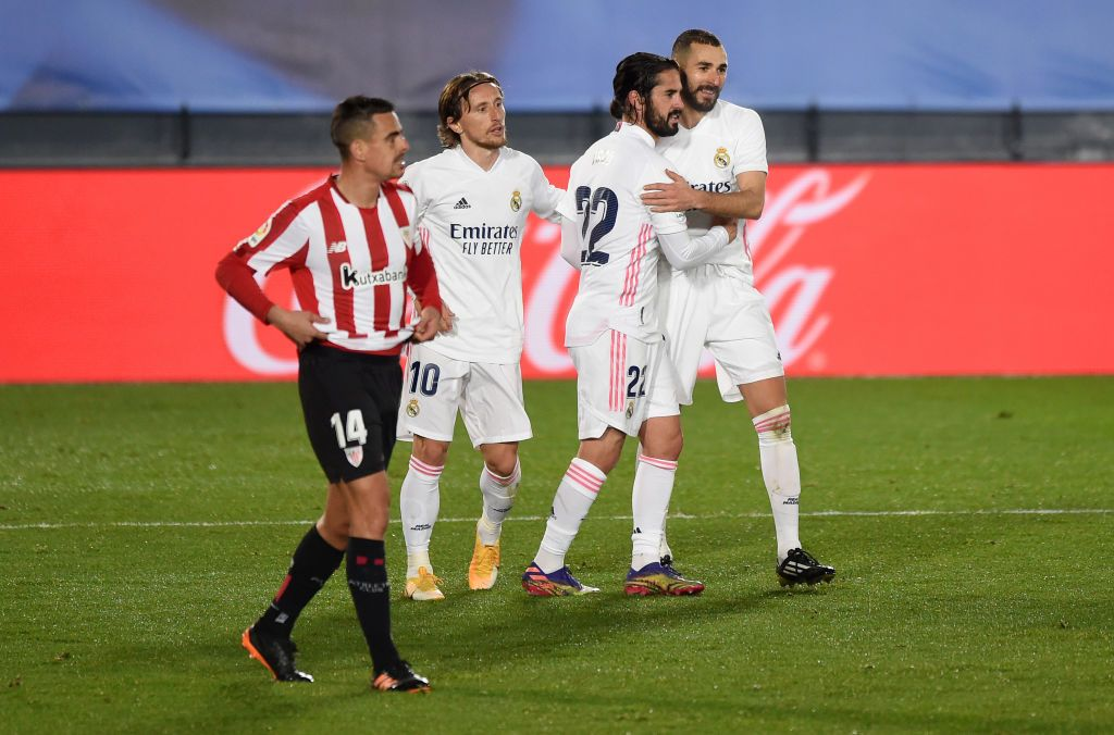 MADRID, SPAIN - DECEMBER 15: Karim Benzema of Real Madrid celebrates with Luka Modric and Isco after scoring his sides third goal as Dani Garcia of Athletic Bilbao reacts during the La Liga Santander match between Real Madrid and Athletic Club at Estadio Alfredo Di Stefano on December 15, 2020 in Madrid, Spain. Sporting stadiums around Spain remain under strict restrictions due to the Coronavirus Pandemic as Government social distancing laws prohibit fans inside venues resulting in games being played behind closed doors.  (Photo by Denis Doyle/Getty Images)