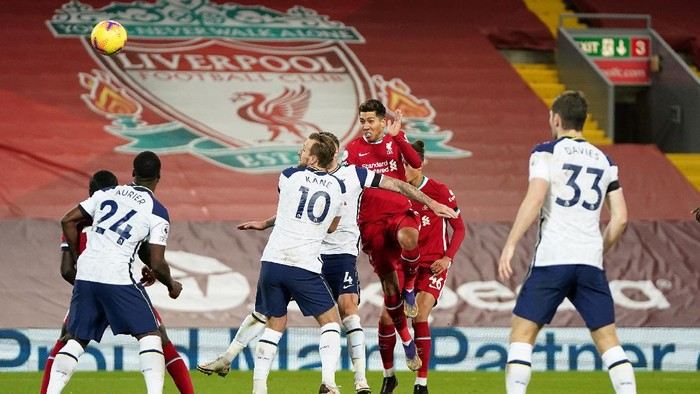 LIVERPOOL, ENGLAND - DECEMBER 16: Roberto Firmino of Liverpool scores their teams second goal during the Premier League match between Liverpool and Tottenham Hotspur at Anfield on December 16, 2020 in Liverpool, England. A limited number of fans (2000) are welcomed back to stadiums to watch elite football across England. This was following easing of restrictions on spectators in tiers one and two areas only. (Photo by Jon Super - Pool/Getty Images)