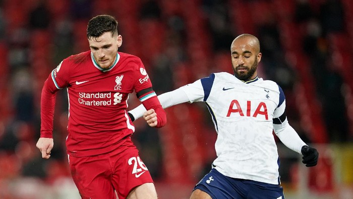 LIVERPOOL, ENGLAND - DECEMBER 16: Lucas Moura of Tottenham Hotspur battles for possession with Andrew Robertson of Liverpool during the Premier League match between Liverpool and Tottenham Hotspur at Anfield on December 16, 2020 in Liverpool, England. A limited number of fans (2000) are welcomed back to stadiums to watch elite football across England. This was following easing of restrictions on spectators in tiers one and two areas only. (Photo by Jon Super - Pool/Getty Images)