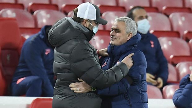 Liverpool's manager Jurgen Klopp, left greet Tottenham's manager Jose Mourinho on the side lines prior to kick off of the English Premier League soccer match between Liverpool and Tottenham Hotspur at Anfield in Liverpool, England, Wednesday, Dec., 16, 2020. (Peter Powell/ Pool via AP)