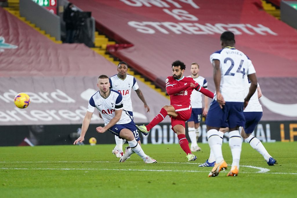 LIVERPOOL, ENGLAND - DECEMBER 16: Mohamed Salah of Liverpool shoots past Eric Dier of Tottenham Hotspur  during the Premier League match between Liverpool and Tottenham Hotspur at Anfield on December 16, 2020 in Liverpool, England. A limited number of fans (2000) are welcomed back to stadiums to watch elite football across England. This was following easing of restrictions on spectators in tiers one and two areas only. (Photo by Jon Super - Pool/Getty Images)