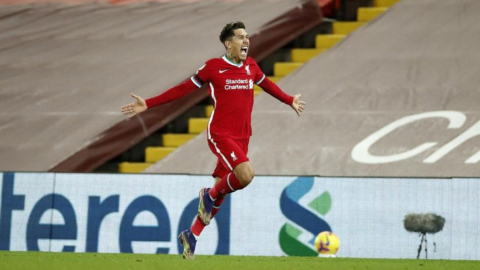 LIVERPOOL, ENGLAND - DECEMBER 16: Roberto Firmino of Liverpool celebrates after scoring their teams second goal  during the Premier League match between Liverpool and Tottenham Hotspur at Anfield on December 16, 2020 in Liverpool, England. A limited number of fans (2000) are welcomed back to stadiums to watch elite football across England. This was following easing of restrictions on spectators in tiers one and two areas only. (Photo by Clive Brunskill/Getty Images)