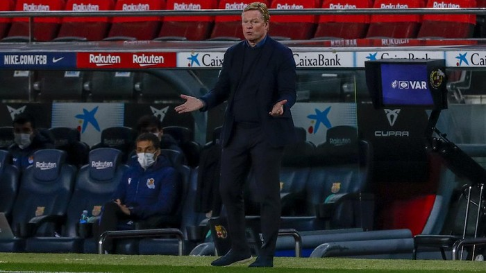 Barcelonas head coach Ronald Koeman gives instruction inside the box team area during the Spanish La Liga soccer match between FC Barcelona and Real Sociedad at the Camp Nou stadium in Barcelona, Spain, Wednesday, Dec. 16, 2020. (AP Photo/Joan Monfort)