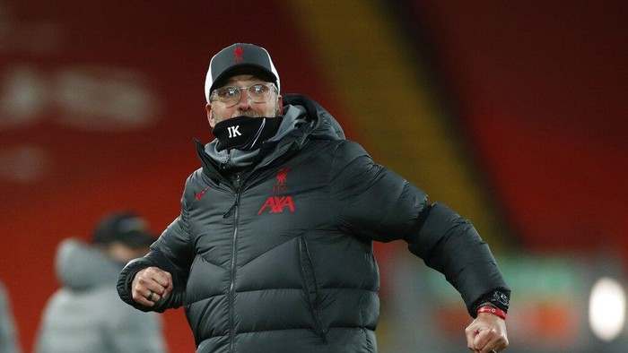 Liverpools manager Jurgen Klopp celebrates towards the fans after the end of the English Premier League soccer match between Liverpool and Tottenham Hotspur at Anfield in Liverpool, England, Wednesday, Dec., 16, 2020. Liverpool won the game 2-1. (Clive Brunskill/ Pool via AP)