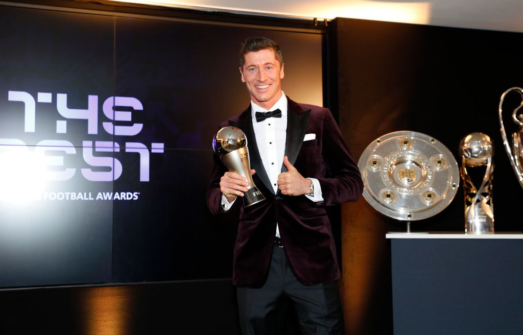 MUNICH, GERMANY - DECEMBER 17: Robert Lewandowski of FC Bayern Muenchen poses after winning the FIFA Men's Player 2020 trophy during the FIFA The BEST Awards ceremony on December 17, 2020 in Munich, Germany. (Photo by Pool/Marco Donato-FC Bayern/Pool via Getty Images)