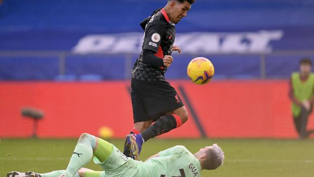 Liverpool's Roberto Firmino, top, scores his side's fifth goal during the English Premier League soccer match between Crystal Palace and Liverpool at Selhurst Park stadium in London, Saturday, Dec. 19, 2020. (Justin Setterfield/Pool via AP)
