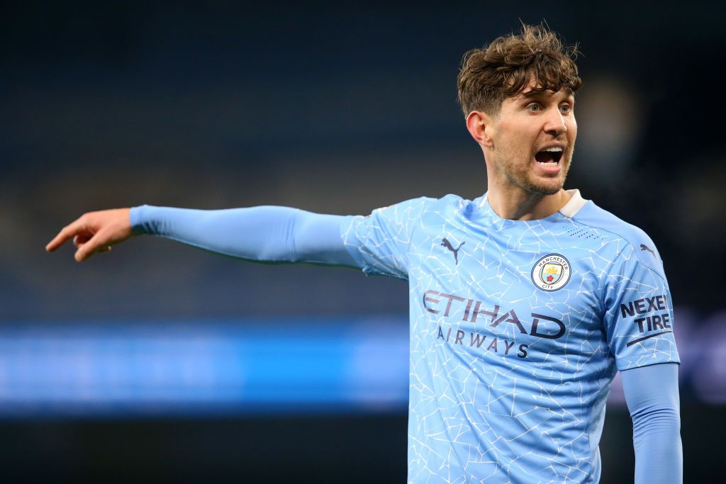 MANCHESTER, ENGLAND - DECEMBER 05: John Stones of Manchester City gives his team instructions during the Premier League match between Manchester City and Fulham at Etihad Stadium on December 05, 2020 in Manchester, England. The match will be played without fans, behind closed doors as a Covid-19 precaution. (Photo by Alex Livesey/Getty Images)