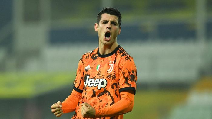 PARMA, ITALY - DECEMBER 19:  Alvaro Morata of Juventus F.C.  celebrates after scoring their teams fourth goal during the Serie A match between Parma Calcio and Juventus at Stadio Ennio Tardini on December 19, 2020 in Parma, Italy. Sporting stadiums around Italy  remain under strict restrictions due to the Coronavirus Pandemic as Government social distancing laws prohibit fans inside venues resulting in games being played behind closed doors. (Photo by Alessandro Sabattini/Getty Images)
