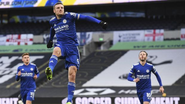 Leicester's Jamie Vardy celebrates after scoring the opening goal of the game from the penalty spot during the English Premier League soccer match between Tottenham Hotspur and Leicester City at the White Hart Lane stadium in London, Sunday, Dec., 20 2020. (Andy Rain/ Pool via AP)