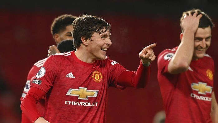 Manchester Uniteds Victor Lindelof, left, celebrates with team mates after scoring his sides fourth goal during an English Premier League soccer match between Manchester United and Leeds United at the Old Trafford stadium in Manchester, England, Sunday Dec. 20, 2020. (Michael Regan/Pool via AP)