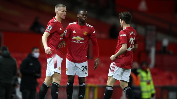 MANCHESTER, ENGLAND - DECEMBER 20: Scott McTominay of Manchester United celebrates with Aaron Wan-Bissaka and Daniel James  after scoring their teams first goal  during the Premier League match between Manchester United and Leeds United at Old Trafford on December 20, 2020 in Manchester, England. The match will be played without fans, behind closed doors as a Covid-19 precaution. (Photo by Nick Potts - Pool/Getty Images)