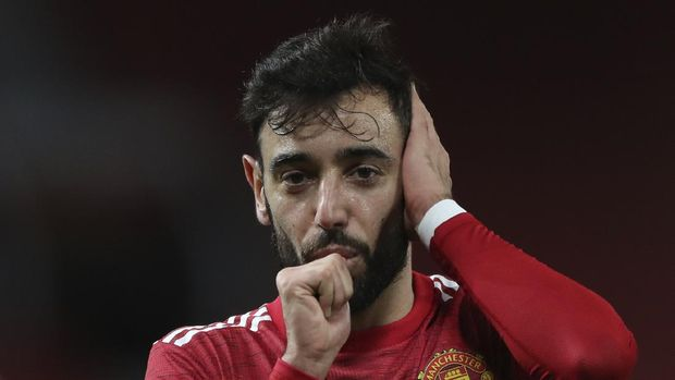 Manchester United's Bruno Fernandes celebrates after scoring his side's third goal during an English Premier League soccer match between Manchester United and Leeds United at the Old Trafford stadium in Manchester, England, Sunday Dec. 20, 2020. (Nick Pottsl/Pool via AP)