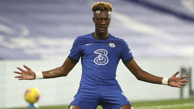 Chelsea's Tammy Abraham celebrates after scoring his team's second goal during the English Premier League soccer match between Chelsea and West Ham at Stamford Bridge, London, Monday, Dec. 21, 2020. (AP Photo/Clive Rose,Pool)