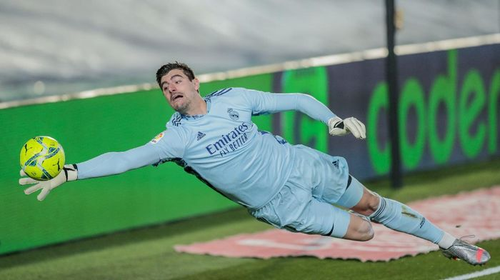 Real Madrids goalkeeper Thibaut Courtois stops a ball during the Spanish La Liga soccer match between Real Madrid and Athletic Club Bilbao at the Alfredo Di Stefano stadium in Madrid, Spain, Tuesday, Dec. 15, 2020. (AP Photo/Bernat Armangue)