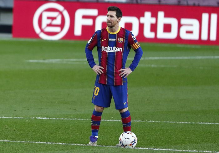 Barcelonas Lionel Messi waits in the centre circle to restart the match after Valencia scored the opening goal of the game during the Spanish La Liga soccer match between Barcelona and Valencia at the Camp Nou stadium in Barcelona, Spain, Saturday, Dec. 19, 2020. (AP Photo/Joan Monfort)