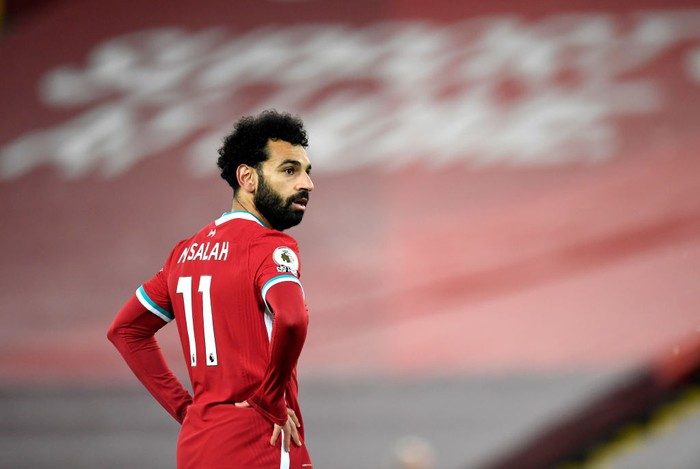 LIVERPOOL, ENGLAND - DECEMBER 06: Mohamed Salah of Liverpool looks on during the Premier League match between Liverpool and Wolverhampton Wanderers at Anfield on December 06, 2020 in Liverpool, England. A limited number of fans (2000) are welcomed back to stadiums to watch elite football across England. This was following easing of restrictions on spectators in tiers one and two areas only. (Photo by Peter Powell - Pool/Getty Images)
