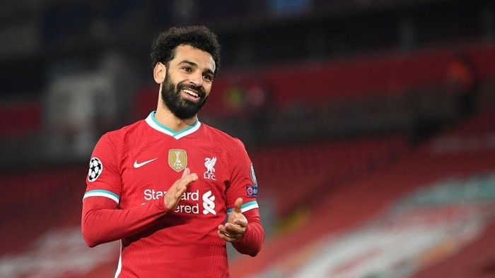 LIVERPOOL, ENGLAND - DECEMBER 01: Mohamed Salah of Liverpool reacts during the UEFA Champions League Group D stage match between Liverpool FC and Ajax Amsterdam at Anfield on December 01, 2020 in Liverpool, England. Sporting stadiums around the UK remain under strict restrictions due to the Coronavirus Pandemic as Government social distancing laws prohibit fans inside venues resulting in games being played behind closed doors. (Photo by Michael Regan/Getty Images)