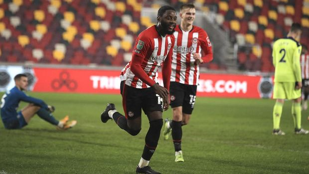 Brentford's Joshua Da Silva celebrates after scoring his side's opening goal during the EFL Cup soccer match between Brentford and Newcastle United at Brentford Community Stadium in London, England, Tuesday, Dec. 22, 2020. (Adam Davy/Pool via AP)