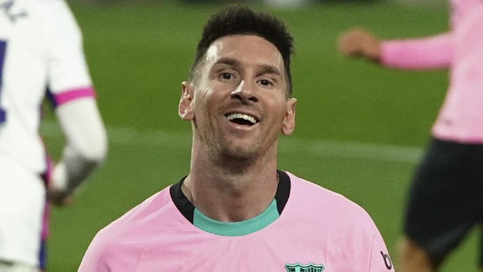 Barcelonas Lionel Messi smiles during a Spanish La Liga soccer match between Valladolid and Barcelona at the Jose Zorrilla stadium in Valladolid, Spain,Tuesday Dec. 22, 2020. (Cesar Manso/Pool via AP)