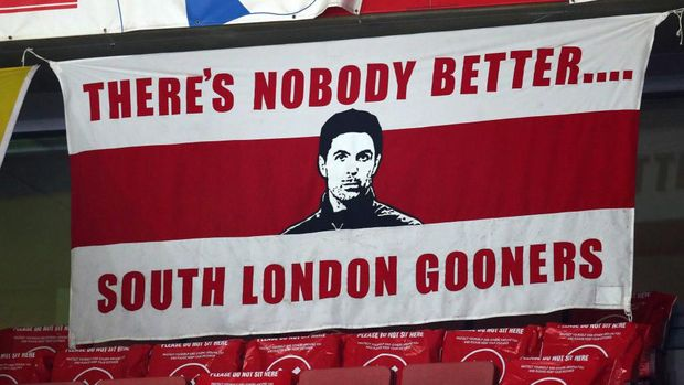 LONDON, ENGLAND - DECEMBER 22: A banner with an image of Mikel Arteta manager of Arsenal saying 'there's nobody better' in the stands during the Carabao Cup Quarter Final match between Arsenal and Manchester City at Emirates Stadium on December 22, 2020 in London, England. The match will be played without fans, behind closed doors as a Covid-19 precaution. (Photo by Catherine Ivill/Getty Images)