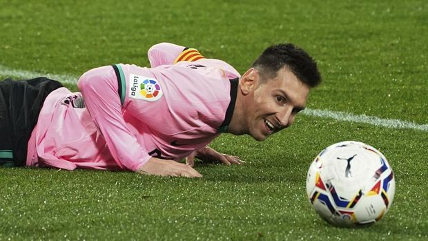 Barcelona's Lionel Messi lies on the ground during a Spanish La Liga soccer match between Valladolid and Barcelona at the Jose Zorrilla stadium in Valladolid, Spain,Tuesday Dec. 22, 2020. (Cesar Manso/Pool via AP)