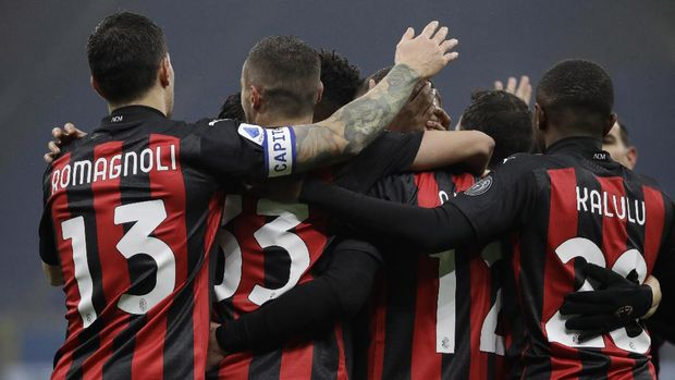 AC Milan' players celebrate a goal against Lazio during a Serie A soccer match between AC Milan and Lazio, at the San Siro stadium in Milan, Italy, Wednesday, Dec. 23, 2020. (AP Photo/Luca Bruno)
