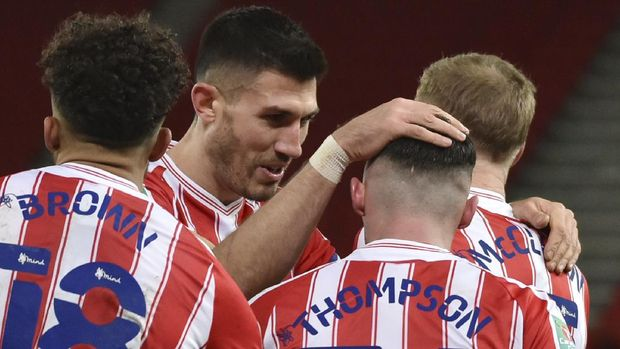 Stoke's Jordan Thompson, 3rd from left, celebrates with team mates after scoring his side's first goal during the English League Cup quarterfinal soccer match between Stoke City and Tottenham Hotspur at the Bet365 Stadium in Stoke on Trent, England, Wednesday Dec. 23, 2020. (AP Photo/Rui Vieira)