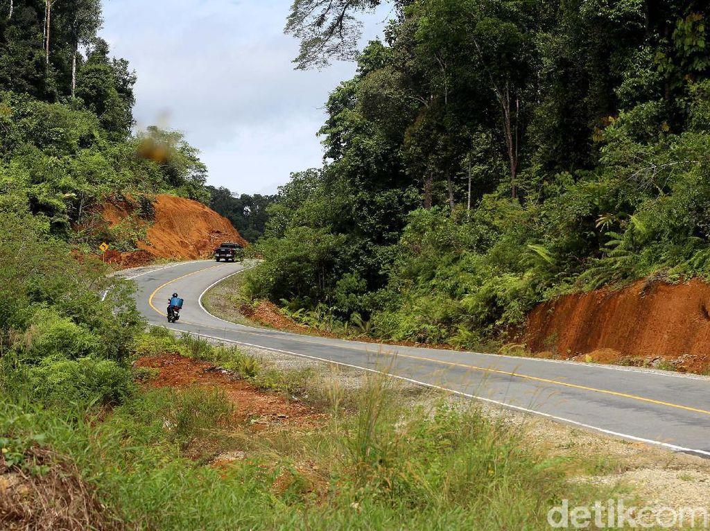 Potret Jalan Mulus di Batas Negeri, Lancarkan Fulus