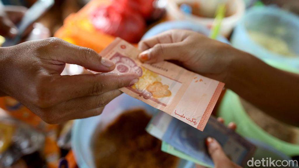 Foto: Belanja di Batas Negeri, Bisa Bayar Pakai Rupiah-Ringgit