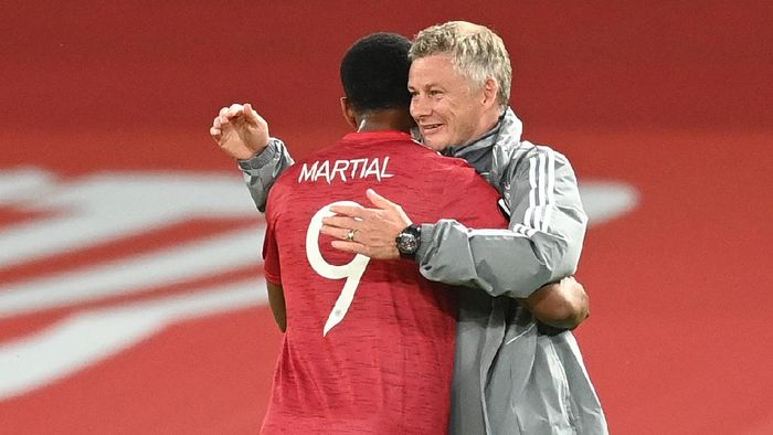 MANCHESTER, ENGLAND - AUGUST 05: Ole Gunnar Solskjaer, Manager of Manchester United embraces Anthony Martial during the UEFA Europa League round of 16 second leg match between Manchester United and LASK at Old Trafford on August 05, 2020 in Manchester, England. (Photo by Michael Regan/Getty Images)