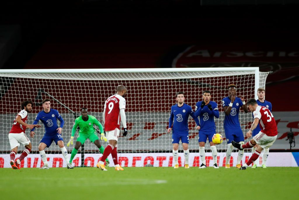 LONDON, ENGLAND - DECEMBER 26: Granit Xhaka of Arsenal crosses the ball during the Premier League match between Arsenal and Chelsea at Emirates Stadium on December 26, 2020 in London, England. The match will be played without fans, behind closed doors as a Covid-19 precaution. (Photo by Adrian Dennis - Pool/Getty Images)