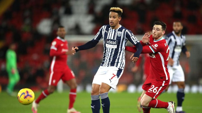 LIVERPOOL, ENGLAND - DECEMBER 27: Callum Robinson of West Bromwich Albion battles for possession with Andrew Robertson of Liverpool during the Premier League match between Liverpool and West Bromwich Albion at Anfield on December 27, 2020 in Liverpool, England. A limited number of fans (2000) are welcomed back to stadiums to watch elite football across England. This was following easing of restrictions on spectators in tiers one and two areas only. (Photo by Nick Potts - Pool/Getty Images)
