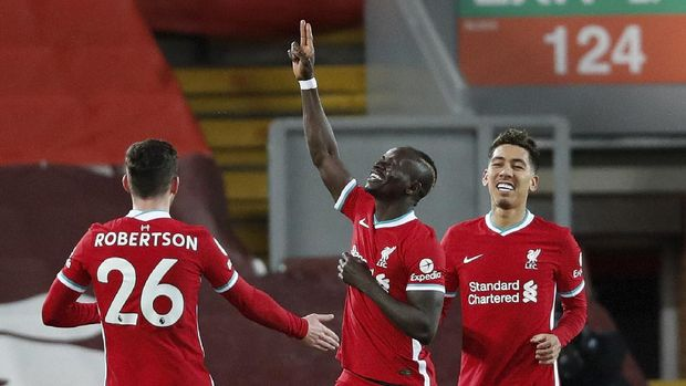 Liverpool's Sadio Mane, centre, celebrates after scoring his side's opening goal during an English Premier League soccer match between Liverpool and West Bromwich Albion at the Anfield stadium in Liverpool, England, Sunday Dec. 27, 2020. (Clive Brunskill/Pool via AP)