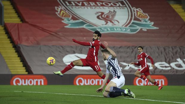 Liverpool's Mohamed Salah, tries a shot on goal during an English Premier League soccer match between Liverpool and West Bromwich Albion at the Anfield stadium in Liverpool, England, Sunday Dec. 27, 2020. (Nick Potts/Pool via AP)