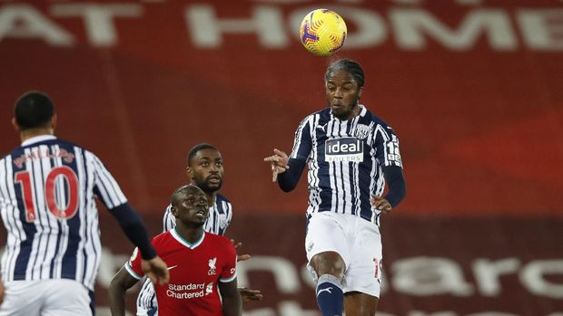 West Bromwich Albion's Romaine Sawyers, right, jumps for a header during an English Premier League soccer match between Liverpool and West Bromwich Albion at the Anfield stadium in Liverpool, England, Sunday Dec. 27, 2020. (Clive Brunskill/Pool via AP)