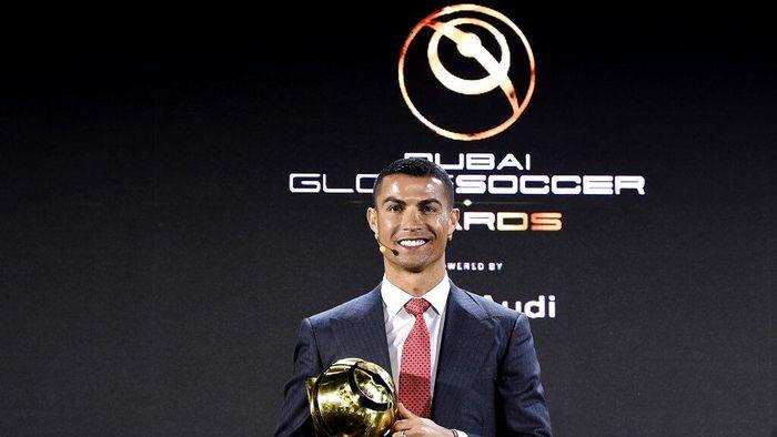 Cristiano Ronaldo poses with the trophy of player of the century at the Dubai Globe Soccer Awards ceremony, in Dubai, United Arab Emirates, Sunday, Dec. 27, 2020. (Fabio Ferrari/LaPresse via AP)