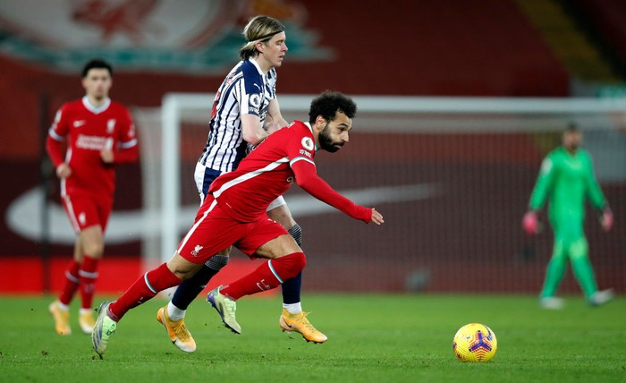 LIVERPOOL, ENGLAND - DECEMBER 27: Mohamed Salah of Liverpool is challenged by Conor Gallagher of West Bromwich Albion during the Premier League match between Liverpool and West Bromwich Albion at Anfield on December 27, 2020 in Liverpool, England. A limited number of fans (2000) are welcomed back to stadiums to watch elite football across England. This was following easing of restrictions on spectators in tiers one and two areas only. (Photo by Clive Brunskill/Getty Images)