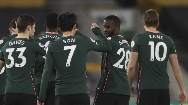 Tottenham's Tanguy Ndombele, second right celebrates with teammates after scoring the opening goal of the game during the English Premier League soccer match between Wolverhampton Wanderers and Tottenham Hotspur at Molineux Stadium, in Woverhampton, England, Sunday, Dec. 27, 2020. (Carl Recine/ Pool via AP)