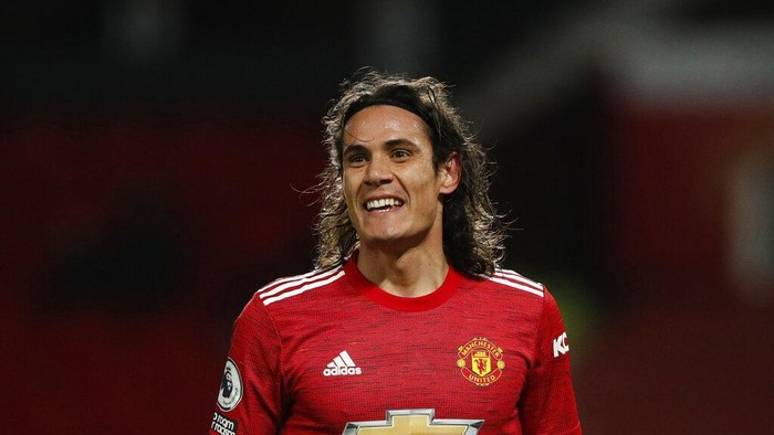 Manchester Uniteds Edinson Cavani smiles after coming on as substitute during an English Premier League soccer match between Manchester United and Leeds United at the Old Trafford stadium in Manchester, England, Sunday Dec. 20, 2020. (Clive Brunskill/Pool via AP)