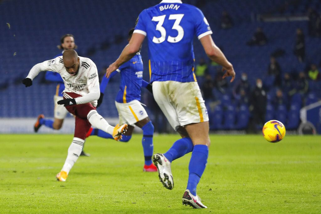 Arsenal's Alexandre Lacazette scores his side's first goal the English Premier League soccer match between Brighton and Arsenal at the Falmer stadium in Brighton, England, Tuesday, Dec. 29, 2020. (AP Photo/Frank Augstein, Pool)